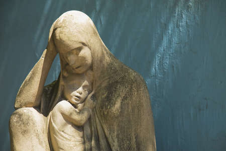 stone statue of the virgin mary holding jesus, buenos aires, argentina photo