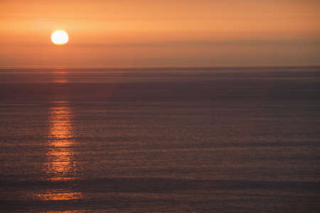 lake fronts: sun over the ocean Stock Photo