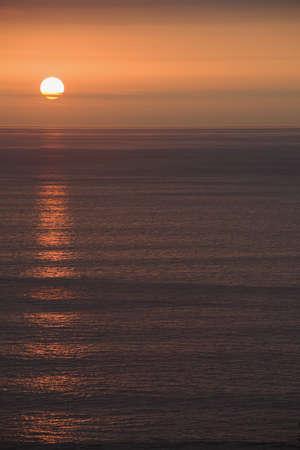 sun over the ocean photo