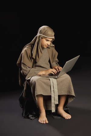 young jesus using a laptop Stock Photo - 7190039