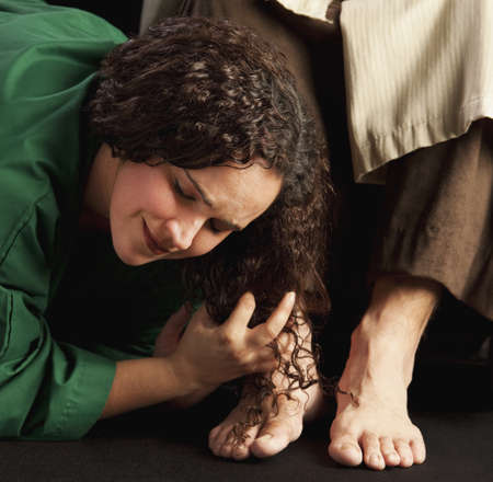 mary magdalene wiping jesus feet photo