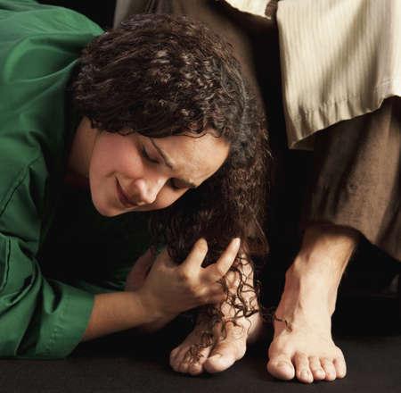 mary and jesus: mary magdalene wiping jesus feet