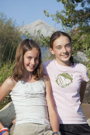sweet seventeen: kananaskis country, alberta, canada; two girls together in the mountains Stock Photo