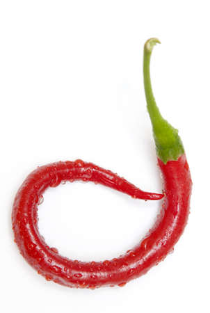 jalapeno pepper: a red jalapeno pepper that has curled