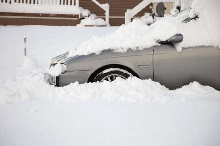 motorcars: a car surrounded by snow Stock Photo