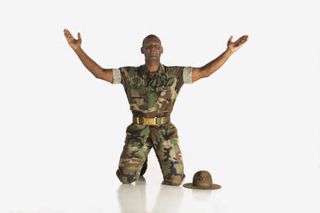 fort lauderdale, florida, united states of america; a military man with arms raised and eyes closed