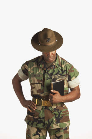 middle aged men: fort lauderdale, florida, united states of america; a military man holding a bible