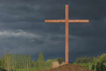 colleen: a cross on a hill with a dark sky Stock Photo