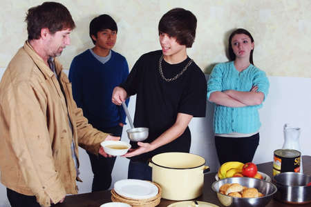 caucasian ancestry: teenagers serving a meal to a man