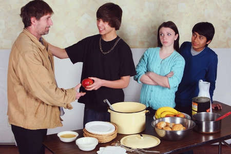 ambivalence: teenagers serving a meal to a man