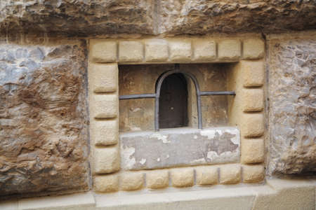 colleen: a miniature door in a stone wall