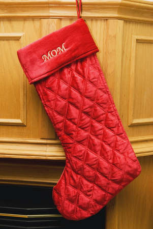 a stocking for mom hung by the fireplace Stock Photo - 7192028