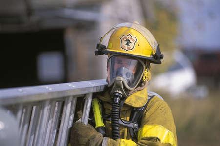 Fireman carrying ladder