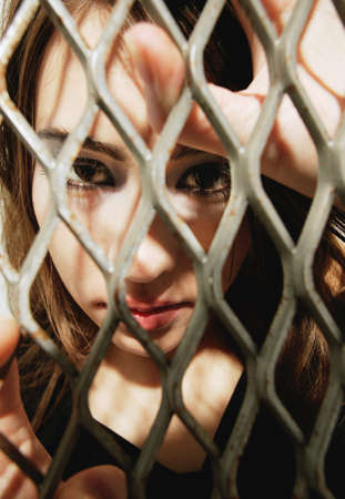 str: Woman behind a fence Stock Photo