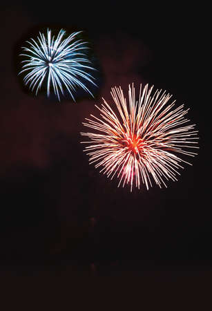 combust: Red and blue fireworks Stock Photo