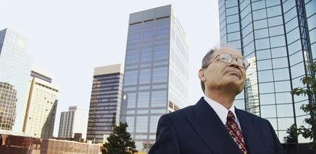 contemplates: Businessman contemplates prospects