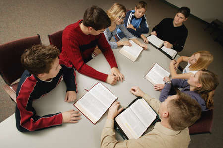 discuss: Young peoples Bible study Stock Photo