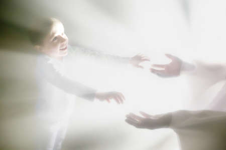 Boy reaches out for Jesus' hands