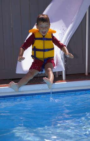 Boy on waterslide Banco de Imagens