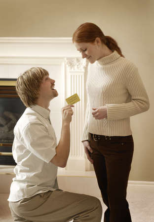kidding: Man proposing to Woman with card