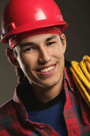 knowledgeable: Aboriginal Workman wearing a hard hat Stock Photo