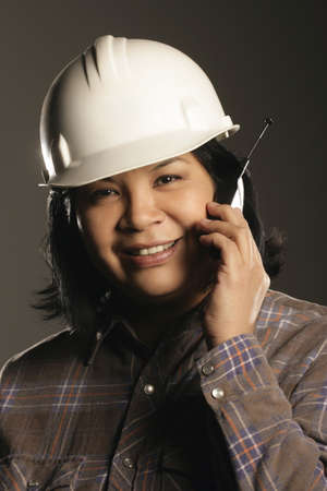 Aboriginal female site worker on cell phone photo