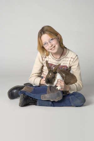 bunny girl: Young girl with pet rabbit