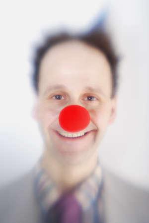 geeky: Man wearing clowns nose