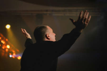 praise and worship: Man worshiping Stock Photo