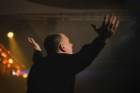Man worshiping Фото со стока