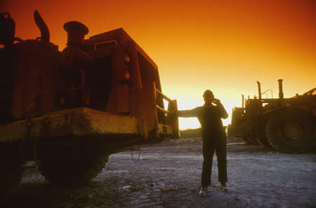 industrial machinery: Early morning worker and vehicle