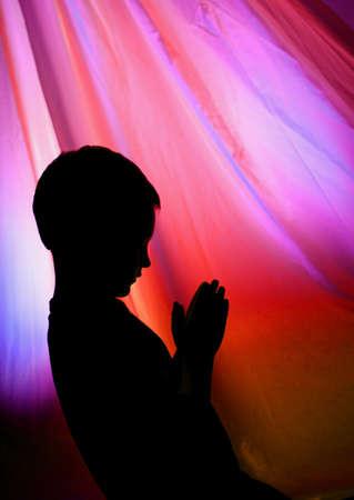 child praying: Young boy praying Stock Photo