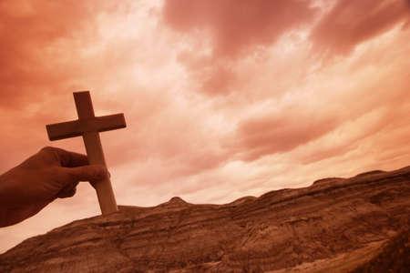 peace plan: Hand holding a cross