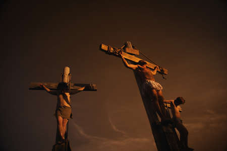 a righteous person: Jesus on cross with two others Stock Photo
