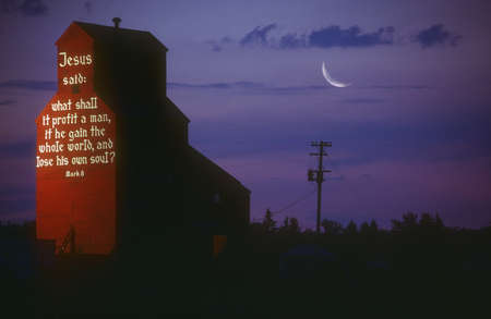 A biblical message on the side of a grain elevator, Nisku, Alberta, Canada photo