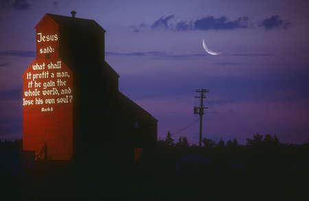 A biblical message on the side of a grain elevator, Nisku, Alberta, Canada