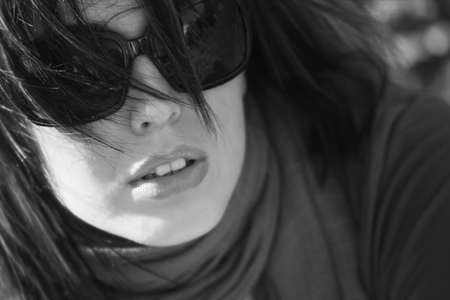 Woman with trendy sunglasses photo