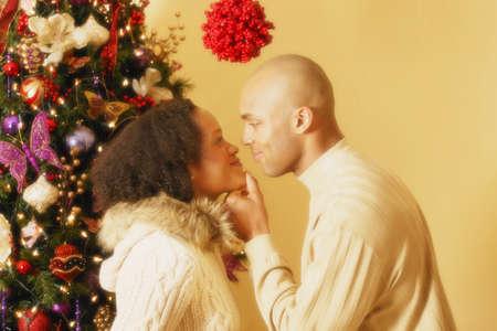black couple: Under the mistletoe