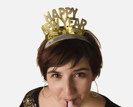 Woman celebrating New Years Stock Photo