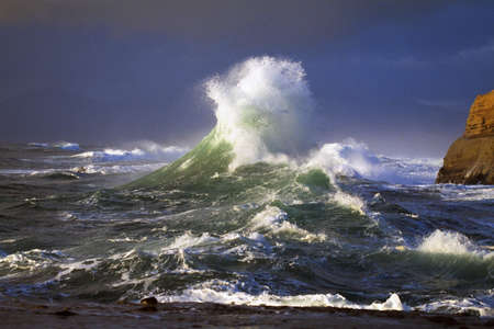 tidal: Wave crashing, distant storm, Cape Kiwanda
