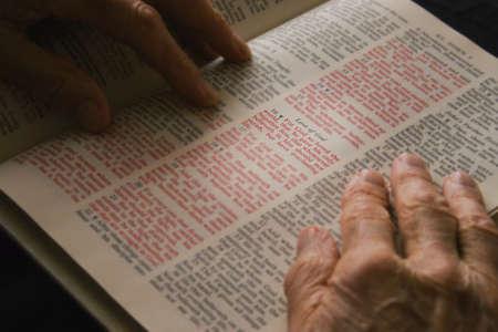 Closeup of senior reading Bible Stock Photo - 7189795