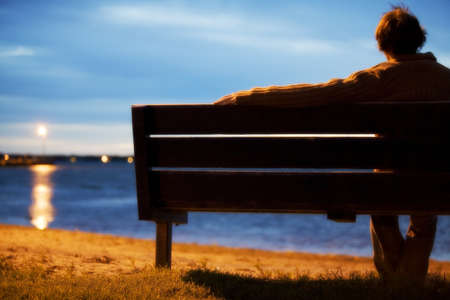 Single man watching sunset Stock Photo - 7189820