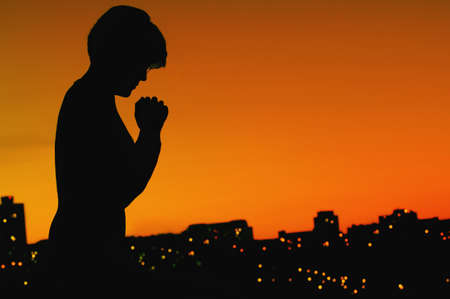 Female silhouette in prayer Stock Photo - 7189800
