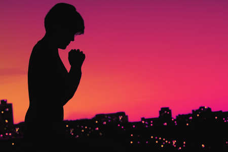 Female silhouette in prayer Stock Photo - 7189796