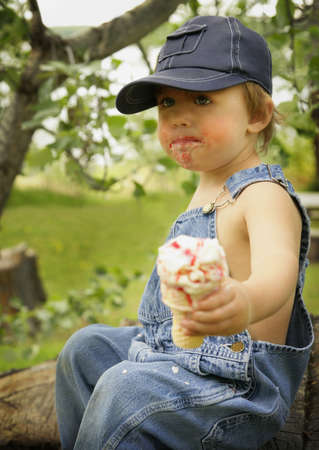 mess: Boy with ice cream cone Stock Photo