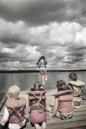 Children watching first water jumper photo