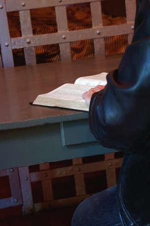 prison: Person reading the Bible in prison