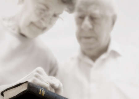 Senior couple praying photo