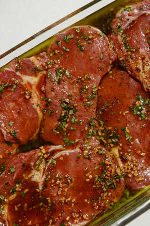 Marinating rib-eye steaks photo