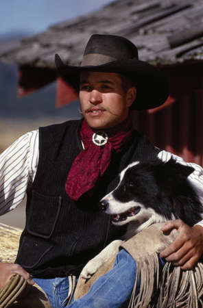 craig tuttle: Cowboy with Border Collie dog Stock Photo